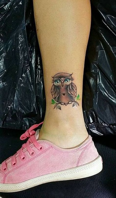 14 - tatto small owl on the lower leg