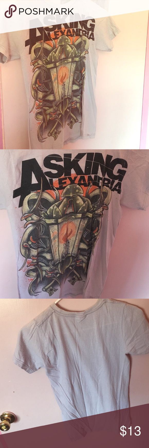 A Hot Topic Asking Alexandria Band Tee This is an original Hot Topic Extra Small band tee. 100% cotton. If your a fan, or just want to complete a couple rocker outfits this is the  gray tee for you. It's a bit wrinkly but other than that good condition at an inexpensive price. The  picture has the bands name on it in black lettering. The middle picture is an antique lamp that has a Melted candle in the middle. The sides are covered in drawings of cob webs, keys and more intricate designs…