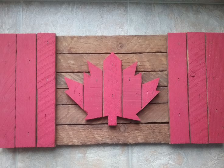 "Celebrate Canada by owning a piece of our Nation's local history by purchasing one of our handmade wooden Canadian flags (18""Wx9""H). Each flag is made from 60-70 year old kiln dried, reclaimed hardwood in Norfolk County.   This flag would look great on your patio or in your cottage. Or you can surprise a friend out of country with a Canadian flag as a special gift."