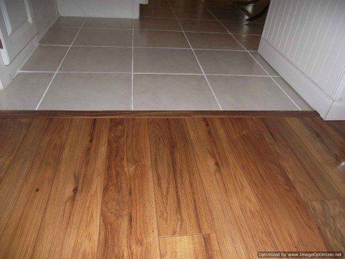 1000 ideas about installing laminate flooring on for Laminate tile squares