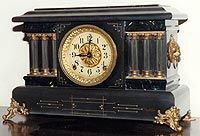 Adamantine clock with three half-pillars by Seth Thomas. mantel clocks were made starting in 1882. Also Adamantine is a celluloid veneer, glued to the wood case. Adamantine veneer was made in black and white, and in colored patterns such as wood grain, onyx and marble (ClockHistory.com, 2014)