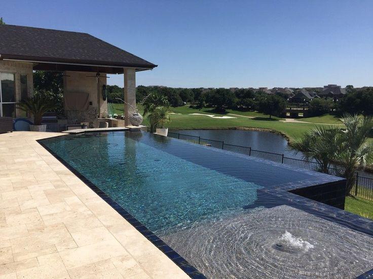 Large elegant backyard rectangular infinity pool photo - Invisible edge pool ...