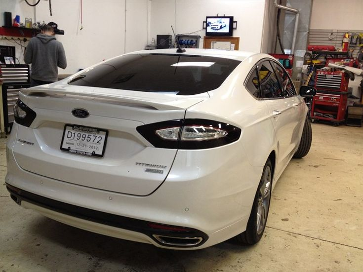 2013 Ford Fusion Titanum smoked LED tail lamps. Makes it even more so like an Aston! Im starting to like these..