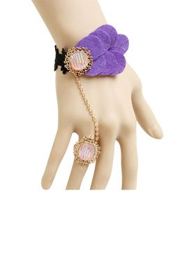 Look at the elegant piece of fashion lace jewelry with Exuberant Purple Lace Bracelet introduced by Return Favors. This is crafted with cotton lace, glassy stone and metal which make your hand look perfectly beautiful and Attractive. Ring enhances you hand beauty for parties and wedding.