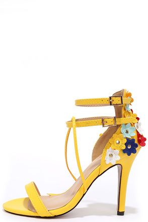 An exciting day is ahead with every step in the New Horizon Yellow High Heel Sandals! Bright yellow vegan leather shapes a single toe strap, and second looping strap that passes through the double ankle straps (with adjustable gold buckles). Heel cup is decorated yellow, red, blue and white floral embellishments.