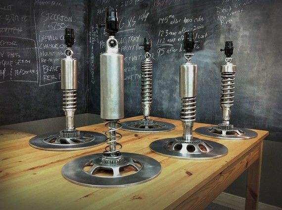 Recycled motorcycle parts into lamps.