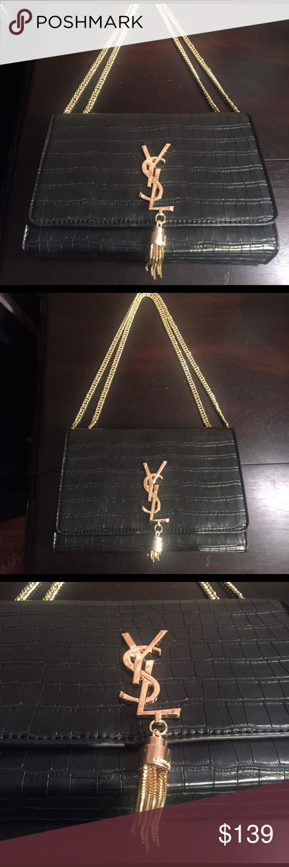 NWOT YSL HANDBAG Never used! Black with gold chain that can be worn short or long. Cute gold tassel adds a nice touch! Gorgeous bag! Yves Saint Laurent Bags Shoulder Bags