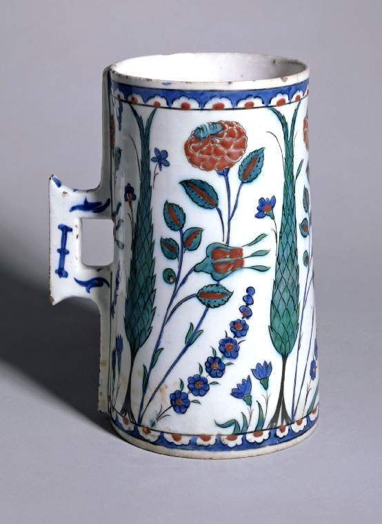Maker: Unknown; potter Category: fritware (stonepaste) Name(s): tankard Islamic pottery; category Iznik; category Date: circa 1565 — circa 1575 School/Style: Ottoman Period: 3rd quarter of 16th century: