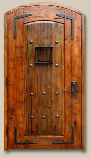 Exterior Door Constructed with antique Mexican door, fitted with large clavos and custom-forged L straps and grillwork. Lever handled hardware with round key flap is cast bronze. 9529-04 McDougall