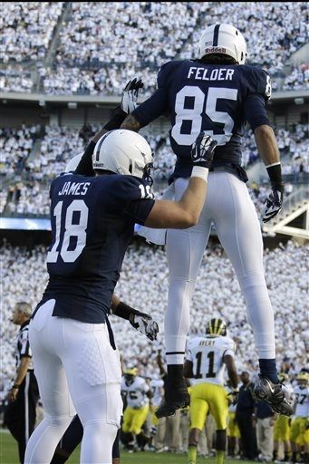 Penn State's Jesse James (18) celebrates with Penn State wide receiver Brandon Felder (85) after Felder scored a touchdown during the first quarter an NCAA college football game against Michigan in State College, Pa., Saturday, Oct. 12, 2013. (AP Photo/Gene J. Puskar)