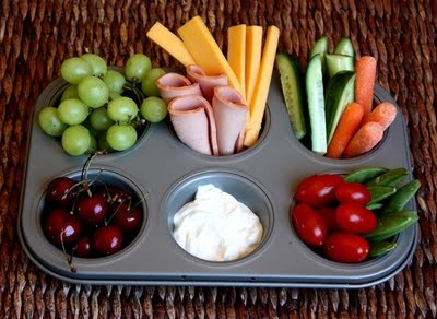 Muffin Tin dinner... or snack or whatever.  BEST idea ever.  My kids LOVE this!!  And it's great when you don't have enough of any one thing to make a meal... you just portion out tidbits! MUFFIN TRAY MONDAYS? Toddlers