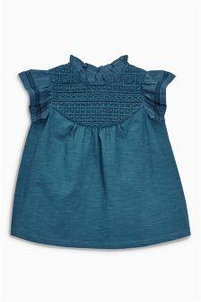 Blauwgroene kanten bloes met panelen (3 mnd-6 jr)