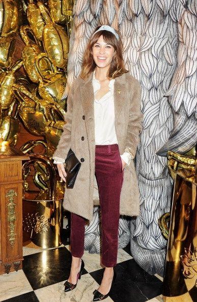 Burgundy pants with a light camel coat