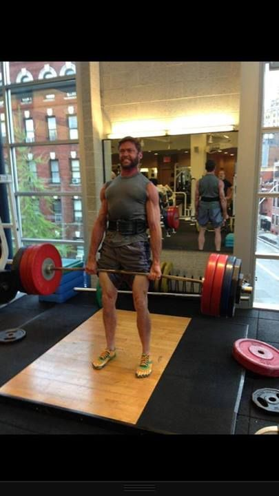 """Wolverine getting that dead lift done and trend setting a new slogan """"if the bar ain't bendin, then you're just pretendin"""". We can't be certain but are fairly sure the beard may help in lifting this amount of weight. #TrainDifferent"""
