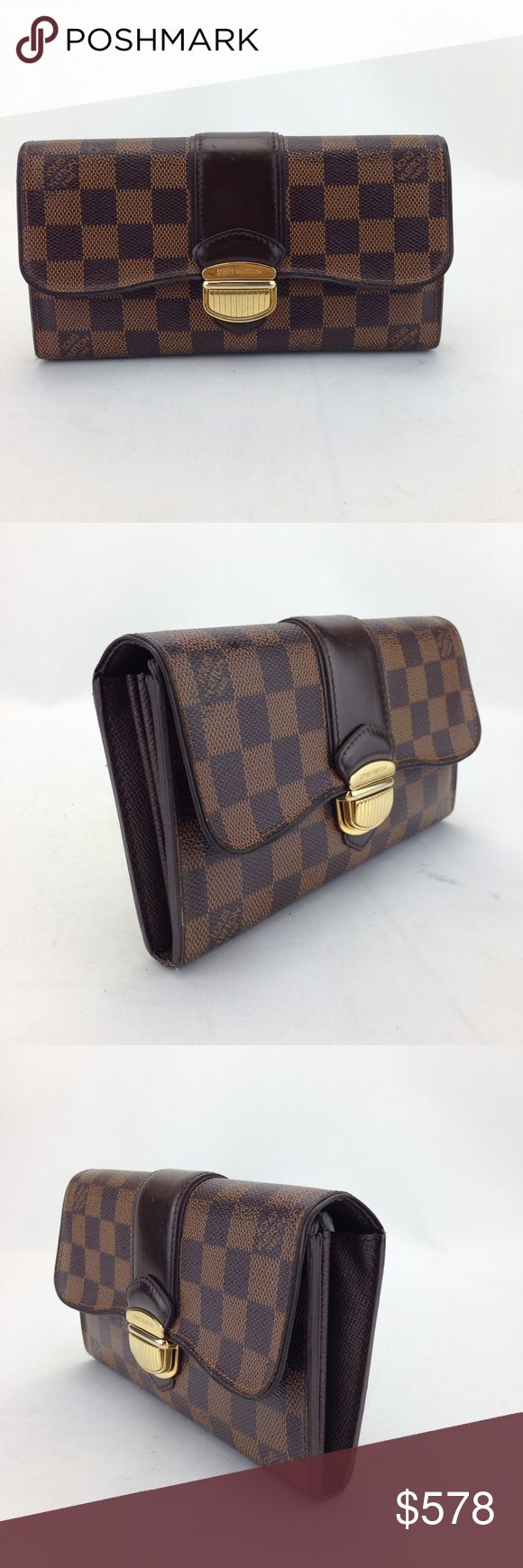 Louis Vuitton Sistina Flap Continental Wallet Louis Vuitton Damier Ebene Sistina Flap Continental Long Wallet in good condition! 100% pre-owned authentic. Date code reads CA4112. Made in Spain. No trade  Exterior features: - brown and tan checkered Damier Ebene coated canvas - solid dark brown leather strip embellishment on flap - push-lock flap closure  Interior features: - dark brown cross-grain textured leather lining - 2 bill slots, 2 open compartments, 16 card slots, and center zippered…