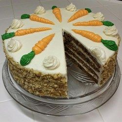 Sam's Famous Carrot Cake Recipe and Video - This carrot cake recipe combines carrots, pineapple, raisins, and walnuts to make a moist and satisfying dessert.