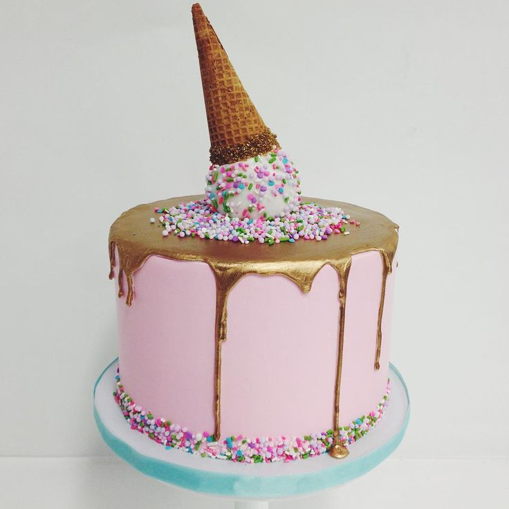 Love this gold drip cake with a cute sprinkled ice cream cone on top!  ~  we ❤ this! moncheribridals.com