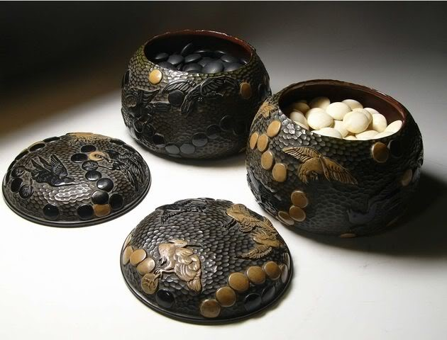 Go Bowls with Storks & Crows Design and Game Pieces. Lacquered Wood and Black & White Stones. Circa Late-19th to Early-20th Centuries.
