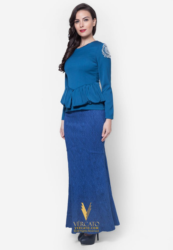 Baju Kurung Moden with Peplum - Vercato Allie in Teal Blue. Buy baju kurung moden with embellished sequins on a peplum silhouette top from the Allie set, accompanied by lace jacquard skirt for maximal feminine allure.SHOP NOW: www.vercato.com