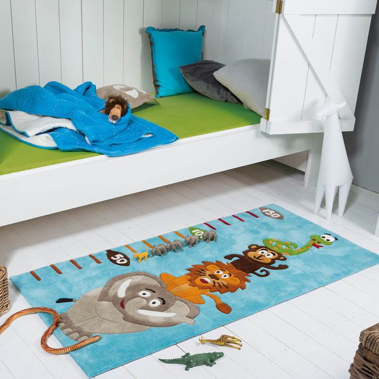 The Kids Line rug from Arte Espina offers a blue size chart design with a playful elephant, lion, monkey and snake.
