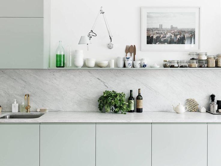 Very pale green cabinets, white carerra marble backsplash