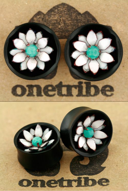 "onetribeorganics: We are ready to show a sneak peek of our new hand cut copper and glass enamel flowers, and we've just finished up a few pairs to take to the Cape Fear Tattoo Festival in North Carolina this weekend. This pair is 1"" (25.4mm) and features a double layer white 12 petal flower with a 6mm prong set amazonite cabochon. Stop by the tattoo fest for a look, and keep an eye on our website for forthcoming pieces available for purchase."