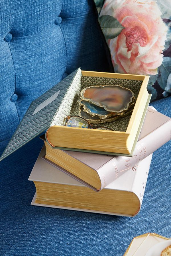 Storage boxes that look like books are a whimsical addition to your reading nook. Use them to keep glasses, bookmarks or drinks coasters close at hand.
