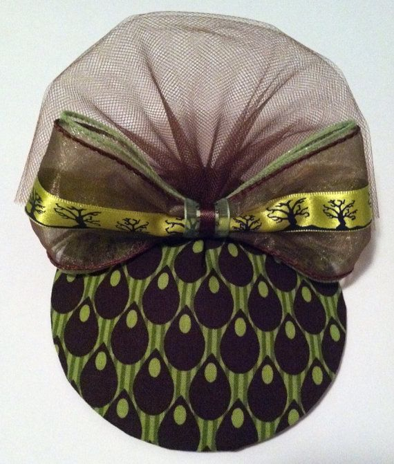 Beautiful brown & green fascinator hat. Portion of sale goes to charity