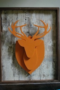this i love. reclaimed wood, mounted, and orange. a diy for sure!