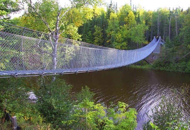 The suspension bridge across the Willow River - Pukaskwa National Park, Ontario