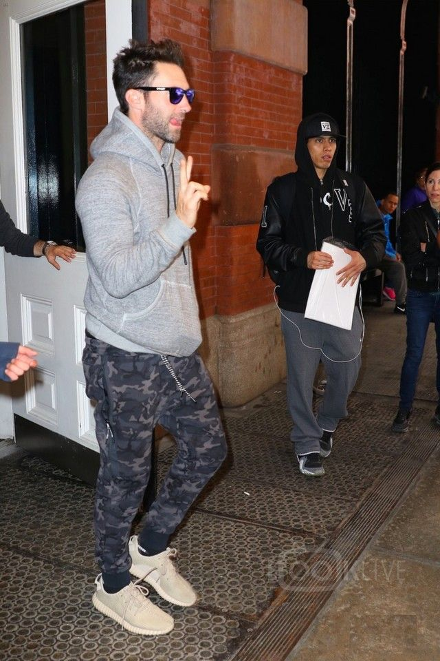 Adam Levine wearing  Nike Tech Fleece Camo Pant, Oakley Frogskins Sunglasses, Adidas Yeezy Boost 350 , Rag