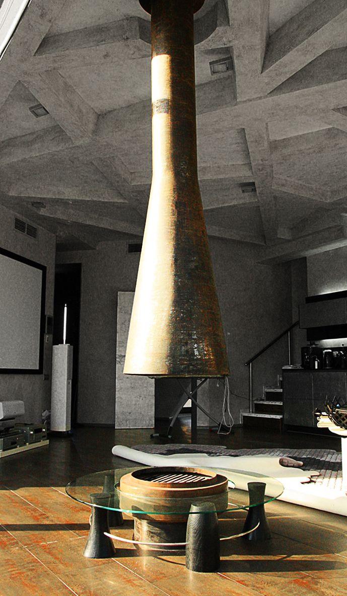 """КАМИН HRONOS. Подвесной камин в Звенигороде по мотивам французского Filiofocus. Стройная ось предсказуемо собирает на себя всё окружающее пространство.  Здесь мы добавляем рельефную коррозию, чтобы получить интенсивный органический эффект. Теперь в нём больше истории, времени.  Отсюда и название - «Хронос».  This hanging chimney is based on the French style """"Filiofocus"""" located in Zvenigorod. The slender axis gives an open feel to the entire space."""