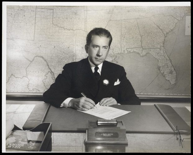 """Portrait of J. Paul Getty (1892-1976), at his desk. """"I am convinced that the true collector does not acquire objects of art for himself alone. (..) appreciating the beauty of the object, he is willing and even eager to  have others share his pleasure"""". From """"The Joys of collecting"""" (1965)."""