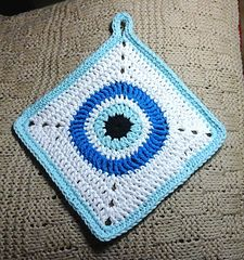 "This is a easy crochet pattern for a dish cloth or pot holder with a traditional Turkish ""evil eye"" design. It was made with Lily 'n' Cream cotton but it is easy to make the pattern larger if you use a slightly finer cotton. Gauge is not important because size adjustments can be made. Total yarn is less than one ball. You will need a very small quantity of black and slightly larger quantities of light turquoise. white and royal blue."