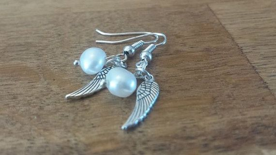 Check out this item in my Etsy shop https://www.etsy.com/uk/listing/246052207/pearl-and-angel-wing-earrings-silver