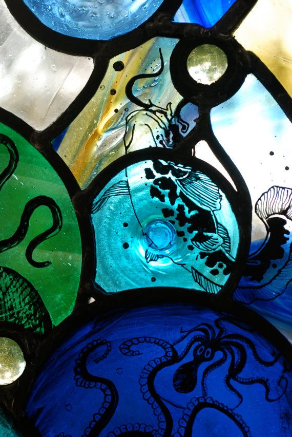 More work examples on haltglass.com or fb : HALTglass    Hand-made, painted and fired traditional stained glass leaded light. Made with mouth-blown English Antique Glass, French roundels, mouth-blown bullions and Vaseline glass marbles which glow a vivid bright green under UV light. Leaded in traditional way. Cathedral quality craftsmanship which should last you about 800 to a 1000 years if you look after it. Inspired by a week spent snorkelling in the Mediterranean Sea off the coast of…