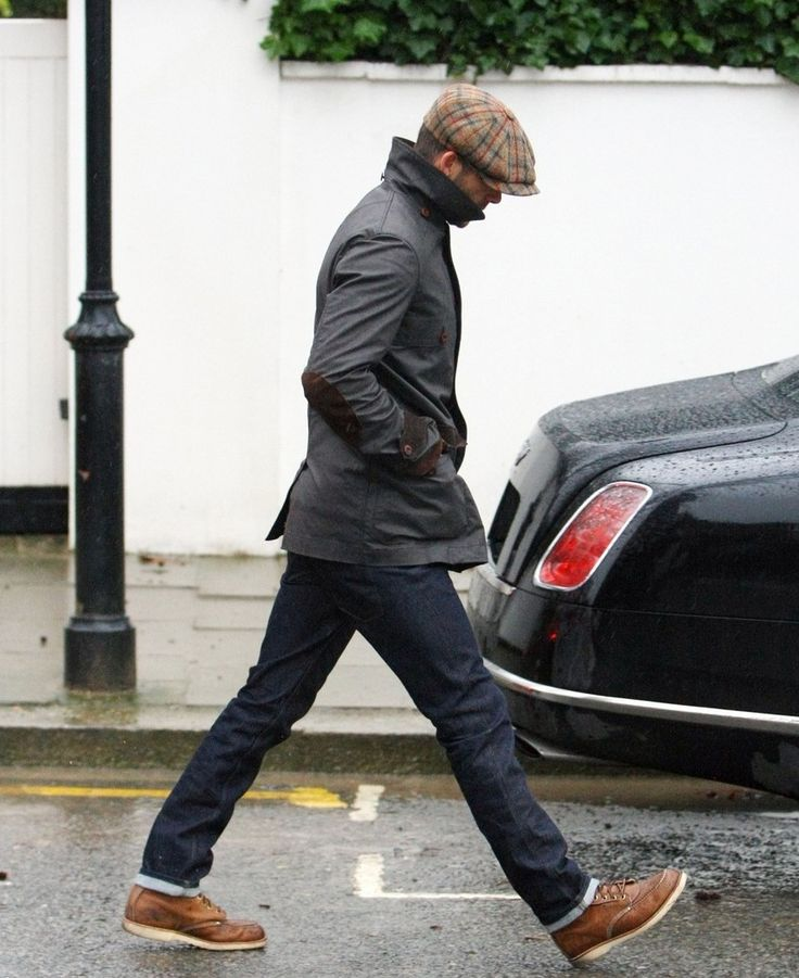 Cap. Wax jacket with elbow patches. Jeans. Shoes. David Beckham.
