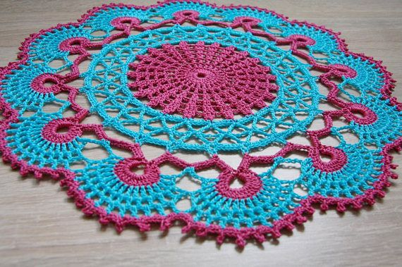 The product is a two-colour crochet doily. The combination of turquoise and fuchsia looks always fashionable and unique. However, it is a brave set of colors - that is suitable as a decoration of small surfaces. Thats why this colorful doily will be a beautiful and modern table decoration. Turquoise and fuchsia are often used to decorate a childrens room.   Measurement: - Diameter - 11 (28 cm)   *The doily pictured is one of a kind and the exact one you will receive *Ready to ship worldwide…
