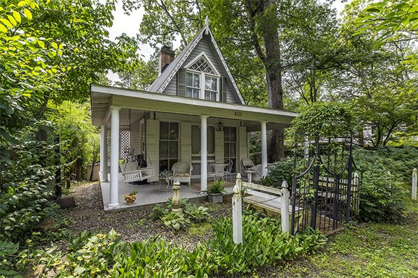 This cute-as-a-button, Victorian Gothic cottage is currently on the market—and we're head-over-heels in love!