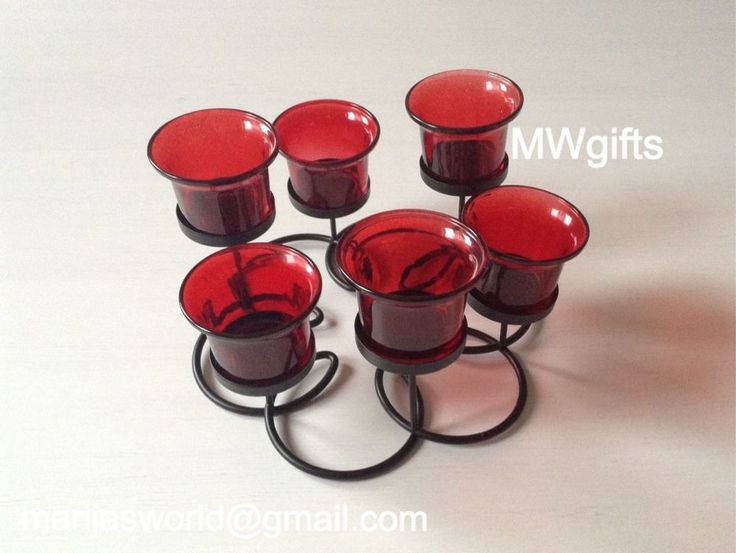 Flower Shaped Black Candle Holder with Six Red Glass Tea Light Holders