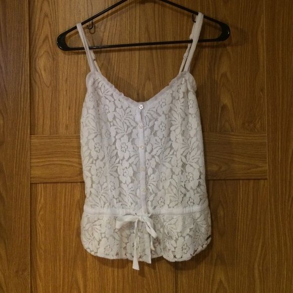 Hollister Fashion Tank Hollister fashion tank top with lace! Size XS. Only flaw is on the ribbon there is a stain. Hollister Tops Tank Tops