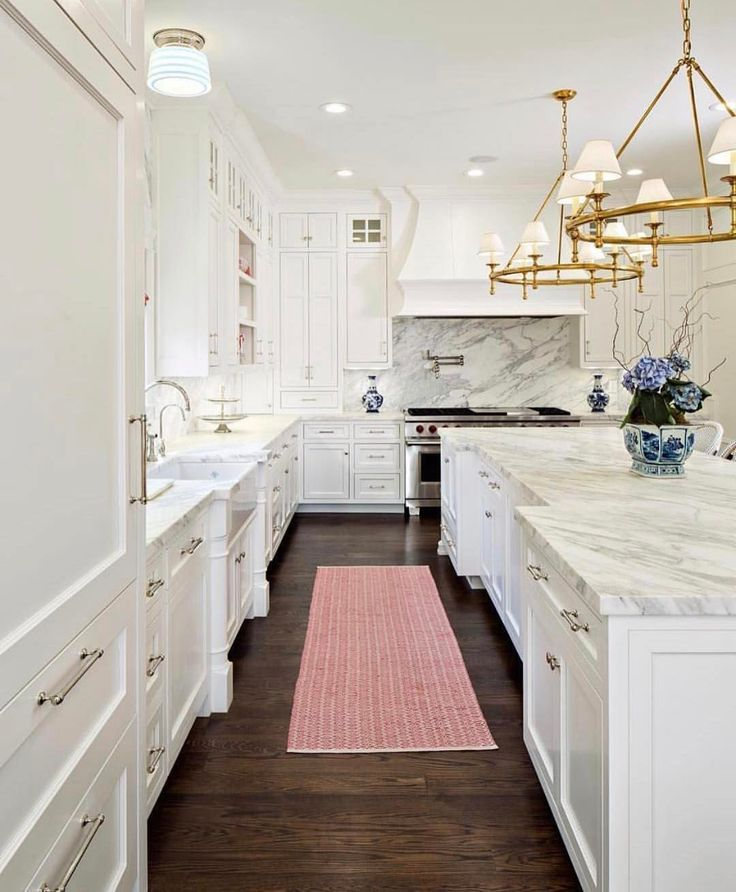 wow - SUCH A MAGNIFIQUE KITCHEN!! - I LOVE THE 'ALL WHITE LOOK' WITH DARK FLOORS! - LOOKS SIMPLY STUNNING WITH THE FANTASTIC LIGHT FITTINGS, AS A FINISHING TOUCH.
