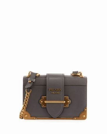18c9f8bc6474 Opt for an instant icon with Prada's leather shoulder bag. This charming  piece is inspired by the bindings of antique books and features aged  gold-tone ...