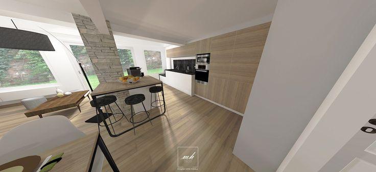Aménagement de l'espace cuisine en plusieurs partie, la première avec un coin repas créé à partir de la colonne au centre du séjour. De cette manière, elle fait partie intégrante du mobilier.