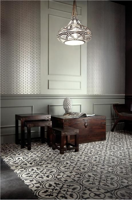 On the wall are Pigeon and Mizzle colours. The amazing wallpaper is Lattice BP3504. space craft cement tiles and the egyptian lamp. dark wooden chest and side tables. Farrow and Ball