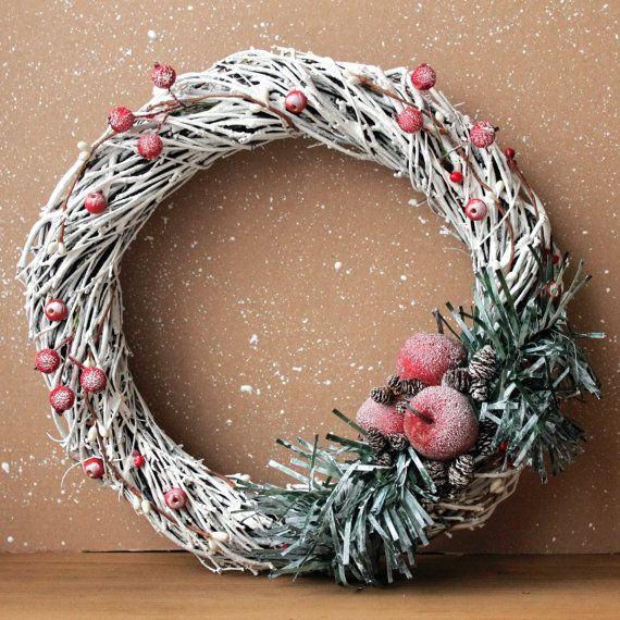Interior #Christmas #wreath on the door in white with red accents. The wreath is made from natural birch branches decorated with artificial fir branches, red apples, berries,... #etsy #christmas
