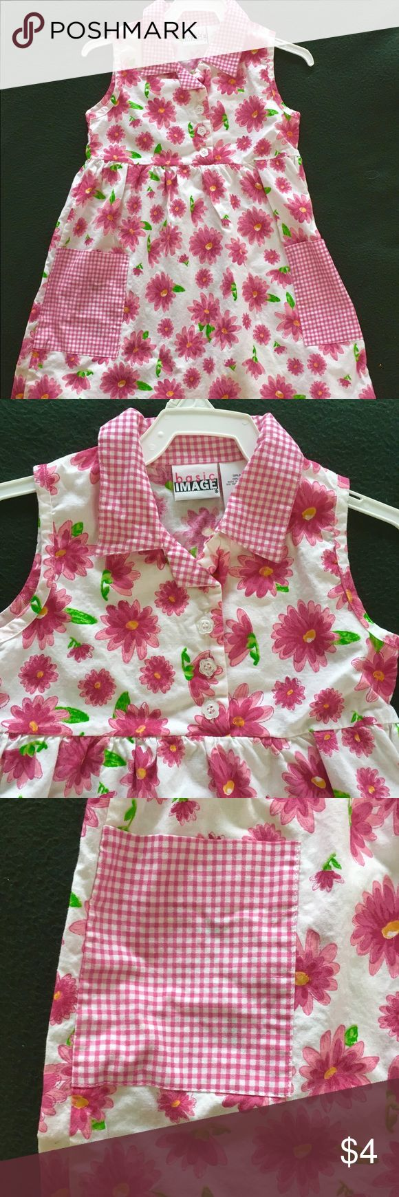 *Kids* 🌸🌸 Pink floral dress 🌸🌸 *Kids* 🌸🌸 Pink floral dress 🌸🌸. Super cute pink and white floral dress with plaid collar and 3 flower shaped buttons going down the middle. So cute! Perfect for a kindergartner! As always, accepting offers and bundles! basic image Dresses Casual