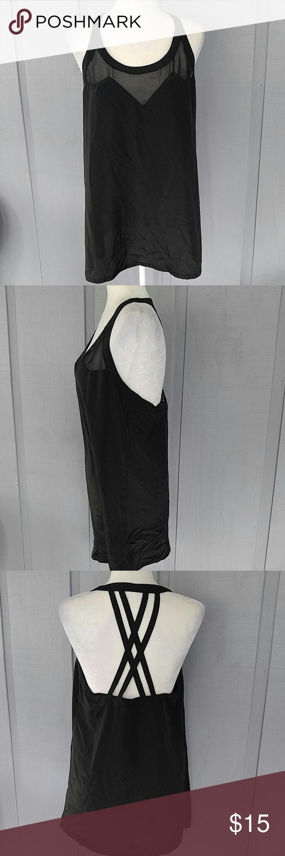 Kardashian Kollection black tank top This is super lightweight with a strappy back.   Super cute Kardashian Kollection Tops Tank Tops