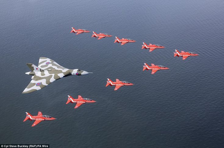 Over water: Thousands of spectators cheered as the Red Arrows' nine British-built Hawk air...