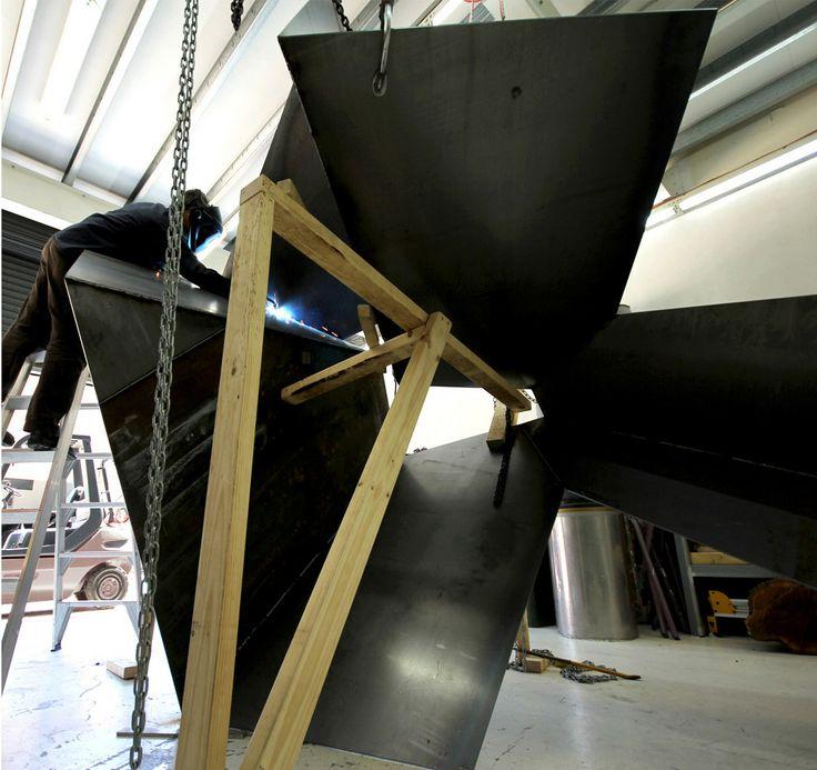 KORBAN/FLAUBERT: OUT, corten/weathering steel sculpture being welded at our metal workshop